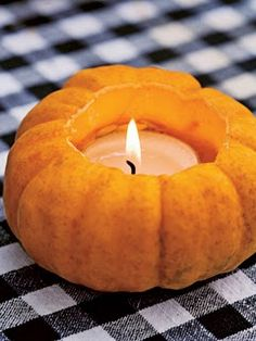 carve out jack-be-little pumpkins and insert votive candles. This festive decoration can be used for Halloween parties, as well as Thanksgiving feasts.