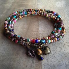 This beaded wrap bracelet is made with , Miyuki beads, Toho beads, Rocaille beads , a metal lobster clasp and a metal heart charm. Fits a wrist of 16 cm = 6.29 inch. Please read my policies before ordering.