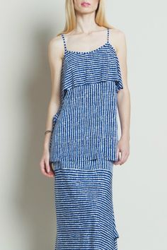 Stripe spaghetti strap soft knit top. Ruffle on the top with horizontal stripes while the body are vertical stripes. Blue and white in color. Wrinkle free fabric must hand wash in cold water hang to dry.  Stripe Spaghetti-Strap Top by Clara Sunwoo. Clothing - Tops - Tees & Tanks Iowa