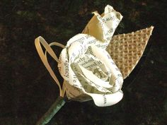 vintage book page paper flower boutonniere or buttonhole with burlap leaf for weddings and prom