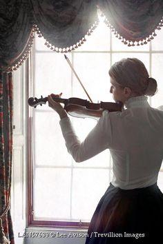 © Lee Avison / Trevillion Images - edwardian-woman-playing-violin