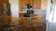Coliseum granite with a 6 cm chipped edge and raised panel style cabinets