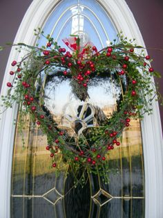 Heart wreath with red berries, perfect for wintery February and Valentines. A heart shaped grapevine wreath filled with bright green mini lotus foliage, red berry branches, and spanish moss. Noel Christmas, Primitive Christmas, All Things Christmas, Christmas Wreaths, Christmas Crafts, Xmas, Winter Christmas, Wreath Crafts, Diy Wreath