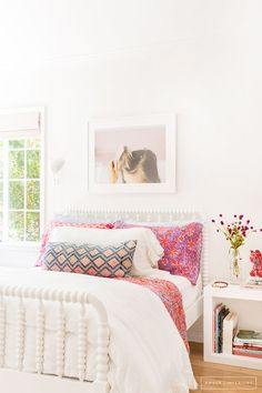 Sweet bedroom with white walls and pink accents.