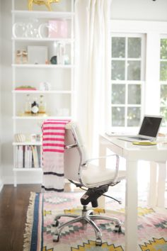 Brighten up your space with a fun carpet.   http://domino.com