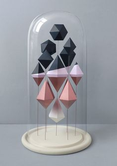 Mark from Present has made three beautiful geometrical paper sculptures that are displayed in glass domes.