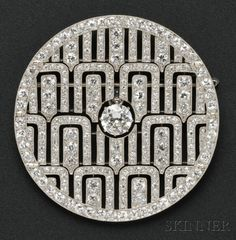 Art Deco Platinum and Diamond Pendant/Brooch, Cartier, France, set with an old European-cut diamond weighing approx. 1.75 cts., further set with old European- and single-cut diamonds, approx. total wt. 12.50 cts., millegrain accents, dia. 2 1/4 in., no. 566, 32, removable armature for pendant conversion, French maker's mark and guarantee stamp, signed. $90,000