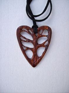 Wood Carved Pendant, Tree of Life Pendant, Wood Jewelry, Cocobolo Wood Pendant, Heart Pendant, Handmade Pendant, Wooden Jewelry. $29.95, via Etsy.