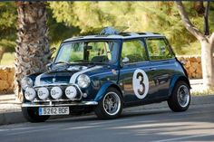 Great looking classic mini . Blue with check roof,cool side decals No3 . Spot lights with covers