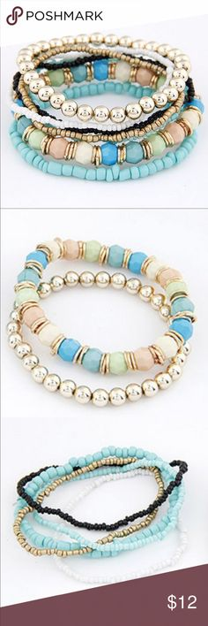 Seven Layered Multicolor Bead Bracelet-BRAND NEW Multicolored Beaded Bracelet with 7 layers.   1 Bracelet with white light pink, green, blue gems and gold tone hoops separating each bead. 1 small teal bracelet and 1 with smaller teal beads. 1 Gold bead bracelet and 1 smaller gold bracelet 1 small white beads bracelet. 1 small black bead bracelet.  Brand New with Gift Box Trendyjewels Jewelry Bracelets