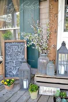 Love the pussywillow in the glass jug, is only be into lanterns if they are really tall. Maybe make or get a chalkboard & have Brittnea do the art for it each week or month