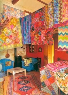 Kaffe Fassett's Quilts.....I made a quilt with some fabrics designed by kaffee and they are amazing fabrics to work with I highly recommend them
