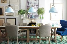"""Dining Room styling for Anthropologie by Kim Ficaro, former Domino editor. Things I see in this: 1) a calm, warm neutral palette punctuated by a well-managed analogous color group (greens and blues) 2) a contrast of textures and shapes in which soft plays with hard, and straight plays with curvy 3) unconventional placement of """"living"""" objects in a """"dining"""" space (e.g. those soft comfy chairs) that invites one to settle in for a while."""