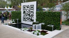 This concept was created by landscape architects Shelley Mosco and Jade Goto for the Royal Horticultural Society Chelsea Flower Show and won the bronze medal for creative use of materials and innovative and  experimental design concepts. When scanned, the code directs to a website with additional information about the garden itself, as well as list of plants that are recommended for individuals who would like to accomplish a similar result. (Website: qrcodegarden.co.uk)