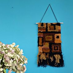Woven wall hanging. Retro brown and mustard yarn. Geometric textile art. Latch hooked on rug canvas. Vintage 1970s vibe. by cupcakecutie1 on Etsy
