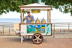 Traditional ice-cream seller with his colourful trolley on the Baie des Citrons