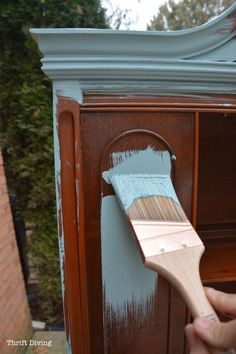 See the before and after of this china cabinet makeover! It was only $40 from the thrift store, and got two coats of robin's egg blue paint. The finish looks awesome! - Thrift Diving