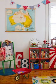 I love these colors & a world map & a globe are a must.  Maybe incorporate planets & rockets too!  the boo and the boy: playrooms