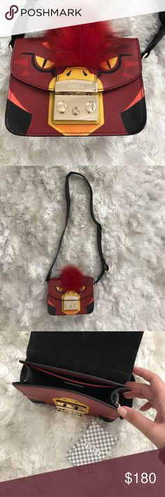 Furla Metropolis Jungle Mini Cross Body Bag Super cute and fun furla mini cross body bag from their spring/summer 2017 jungle capsule collection! Features the parrot design on bag. Purchased through Marianna Hewitt's mystery box. Furla Bags Crossbody Bags