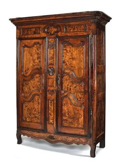 Continental yew wood and fruitwood armoire.: