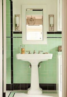 Perfect sink perfect sconces perfect tile for walls and extra perfect tile on floor.  I WANT!