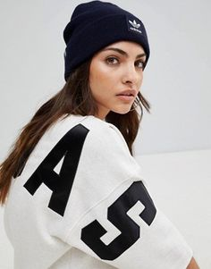 5b99d0790c7 Shop adidas Originals Embroidered Logo Beanie In Navy at ASOS.