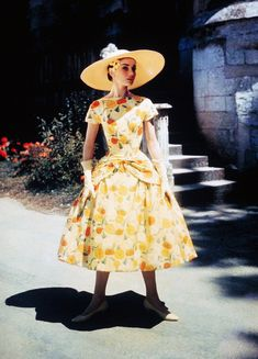 Audrey Hepburn wearing a yellow floral dress by designer Hubert de Givenchy for her film Funny Face, 1956.