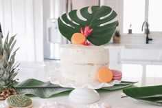 How to throw a Moana Birthday Party with beautiful muted pastels, tropical flowers and plants and a tropical balloon garland Moana Birthday Party, 3rd Birthday Parties, Balloon Garland, Balloons, Moana Cookies, Fish Crackers, Chocolate Art, Fancy Cakes, Betty Crocker