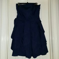 Navy Blue Strapless Dress w/ Cute Design This Gorgeous Navy Blue Dress has the cutest design.....almost like pleated or ruffle, not sure how to explain. It zips up the side as shown in the 4th picture, & is a Size Large. I can usually wear a Large, but this one was too tight. Maybe more of a Junior's Large or Women's Medium. Aqua Dresses Strapless