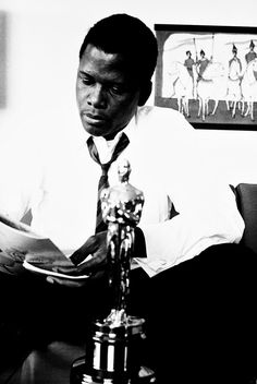 Sidney Poitier at home with his Oscar, c. 1963.