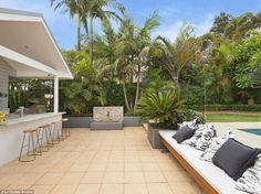 The courtyard is perfect for summer entertaining, with a fully equipped bar, marble benche...