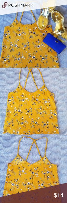 Hollister Top Gently used beautiful  Hollister Top with adjustable straps In a mustard color  Great for the spring & summer !  100% Polyester Hollister Tops
