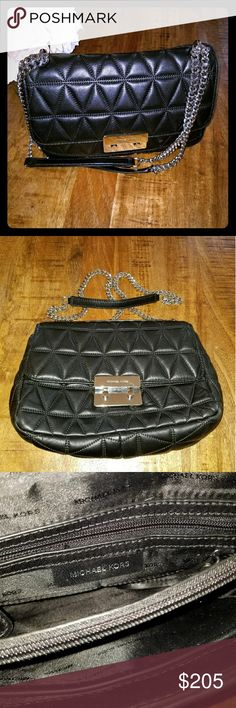 Black Quilted Leather Michael Kors Hand Bag This beautiful bag is soft to the touch. The strap is a sturdy silver chain combined with leather that makes it comfortable to wear on the shoulder or  crossbody. It is previously loved and can be dressed up or down. Michael Kors Bags Crossbody Bags