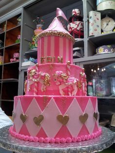 3-tier Pink & Gold Carousel & Circus themed birthday cake froom Charly's…