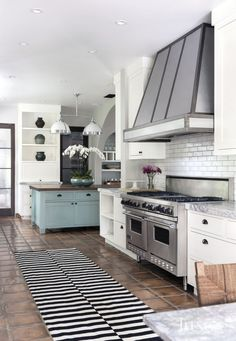 Chic touches and bold details breathe stylish new life into a fashion-savvy family's classic Spanish Colonial-style Beverly Hills home. Home Design, Beverly Hills, Primitive Kitchen, Contemporary Interior Design, Kitchen Contemporary, New Kitchen, Kitchen Ideas, Kitchen Hoods, Kitchen Designs