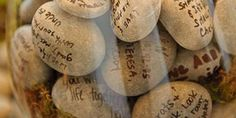 Alternative idea to a formal guestbook: Have guests write their messages on stones instead.