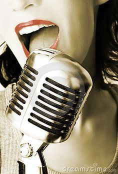 Girl Singing In The Retro Microphone