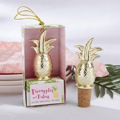 These gold pineapple bottle stoppers are a fun addition to any tropical themed bridal shower or wedding.