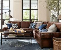 Iron and glass table to lighten room- love the leather sofa for family room- Room Decorating Ideas, Room Décor Ideas & Room Gallery   Pottery Barn