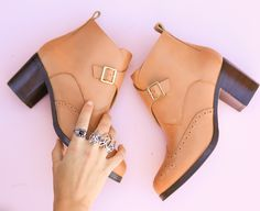 Beautiful brogue detail is the highlight of this elegant tan heel ankle boot. With a buckled strap and block heel. Swan Ankle Boot by Bared Footwear. Men's and women's shoes designed by a podiatrist.