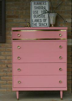 Dresser with gold leafed details