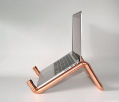 Amazing DIY copper pipe laptop holder (etsy.com) - Industrial Touches: 24 Exposed Copper Pipe Decorating Projects