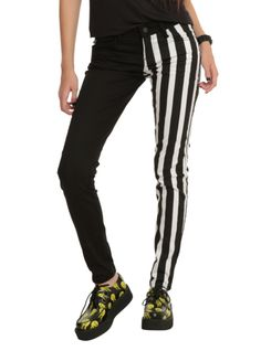 Split leg skinny jeans with a black & white stripe pattern leg and a solid black leg. Classic 5-pocket styling with signature Royal Bones grommets and back pocket design.