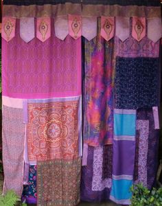 Gypsy curtains- not exactly like these, but this would be a great divider in a studio apartment with some silk handkerchiefs and scarves...