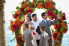 Orange and Green Ceremony Arch by Floral and Event Designer Elena Damy #LosCabosWeddings  {Photo by Alec& T Photography}