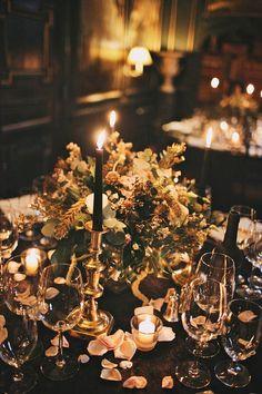 black or dark purple taper candles in gold candlesticks