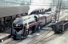 Norfolk Southern operated Norfolk & Western modern streamlined 4-8-4 Northern steam locomotive # 611, is seen in an elevated view at the yar...