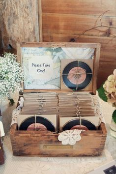 I love this idea.....old singles so the guests one to remind them of your wedding or supply an old record player and your guests can choose there music. Brilliant.!