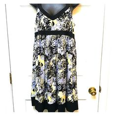 AA Studio Yellow and Black Flower Dress AA Studio Yellow and Black Flower dress. This flower dress has a collection of lovely colors. The colors are yellow,black, gray and white. In great condition. Great for a party or as a vacation dress. Size 10. 95% polyester, 5%spandex. Black straps and trim. AA Studio Dresses Midi