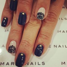 Gel nails. Dark navy blue and nude, with lace designs.